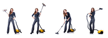 The woman cleaning with vacuum cleaner Stock Images