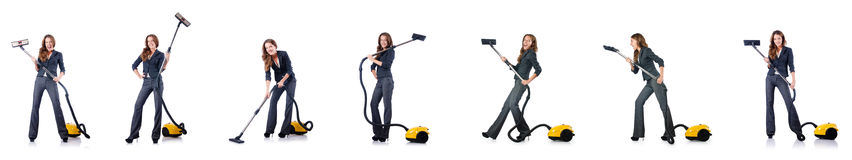 The woman cleaning with vacuum cleaner Stock Photo