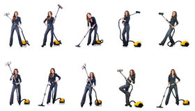 The woman cleaning with vacuum cleaner Royalty Free Stock Photos