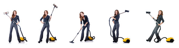 The woman cleaning with vacuum cleaner Stock Photos