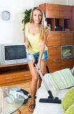 Woman cleaning with vacuum cleaner Stock Photo
