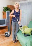 Woman cleaning with vacuum cleaner Royalty Free Stock Photos