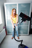 Woman cleaning with the Vacuum Cleaner Stock Photo