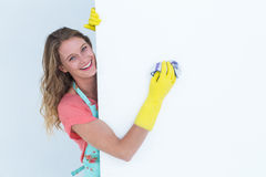 Woman cleaning white poster Royalty Free Stock Photo