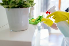Woman cleaning white shelf Royalty Free Stock Photos