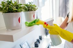 Woman cleaning white shelf Stock Photos