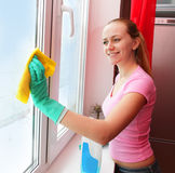 Woman cleaning window stock images