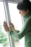 Woman cleaning window. A woman cleaning window with a paper tissue Stock Photo