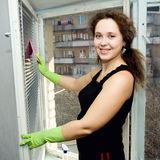 A woman cleaning a window Royalty Free Stock Photos