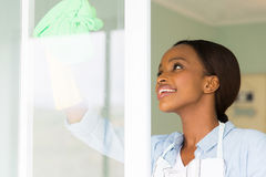 Woman cleaning window glass Stock Image