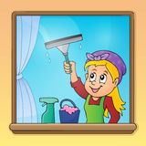 Woman cleaning window image 1 Stock Images