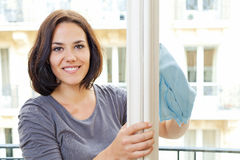 Woman cleaning windowpane Stock Images
