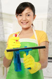 Woman cleaning windows stock photography