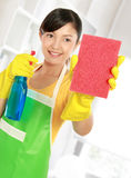 Woman cleaning windows Royalty Free Stock Images