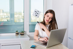Woman cleaning windows with robotic cleaner Royalty Free Stock Images