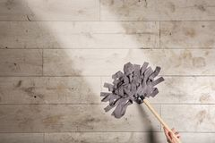 Woman cleaning wooden floor with mop, top view. Space for text royalty free stock images