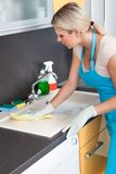 Woman cleaning worktop Stock Photo