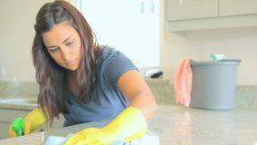 Woman cleaning worktop stock footage