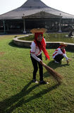 Woman cleaning the yard around the temple Mangkunegaran central java Indonesia Stock Photo