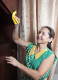 Woman cleans Royalty Free Stock Image