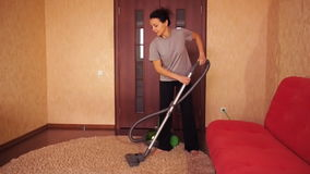 A woman cleans the apartment. stock video footage