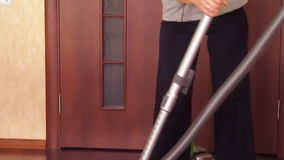A woman cleans the apartment. stock video