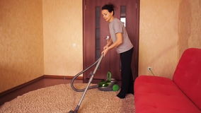 A woman cleans the apartment. stock footage