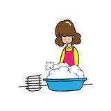 Woman cleans dishes Stock Photo