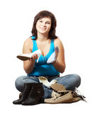 Woman  cleans footwear Stock Photos
