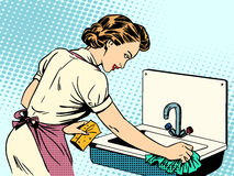 Woman cleans kitchen sink cleanliness housewife. Housework comfort retro style pop art Stock Photography