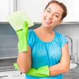 Woman cleans the kitchen Royalty Free Stock Photography