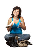 Woman  cleans shoes over white Stock Images
