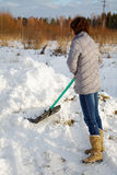 The woman cleans snow Royalty Free Stock Image