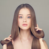 Woman with Clear Skin and Long Healthy Hair Stock Images