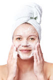 Woman clears a face skin foam Royalty Free Stock Photos