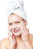 Woman clears a face skin foam Royalty Free Stock Image
