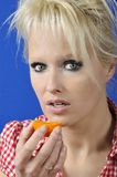 Woman with a clementine Stock Photo
