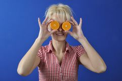 Woman with a clementine Royalty Free Stock Photos