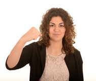 Woman with a clenched fist. Portrait of an attractive young woman with a clenched fist on a white studio background Stock Photos
