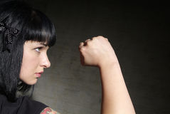 Woman clenches fist Royalty Free Stock Photo