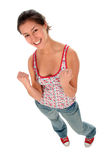 Woman clenching fists. Portrait of a young woman clenching her fists and laughing stock images