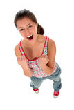 Woman clenching fists. Portrait of a young woman clenching her fists and laughing royalty free stock photos