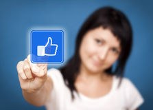 Woman clicking like button. She Likes it!. Woman is touching the like button - Social Media stock photos
