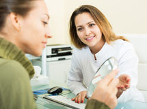 Woman client checking result of beauty procedures Royalty Free Stock Image
