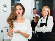 Woman client dissatisfied work of hairdresser Royalty Free Stock Photos