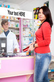 Woman client in drugstore with pharmacist Stock Photos