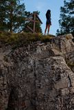 Woman on cliff Stock Photos