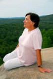 Woman at cliff edge royalty free stock photo