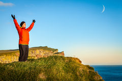 Woman on a cliff Royalty Free Stock Image