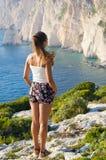 Woman on cliff of Zakynthos island - Agalas, Greece Stock Photography
